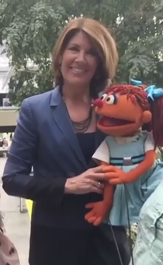 Seasame Workshop's Sherrie Westin and Chamki, a Muppet from India, discuss women's education.