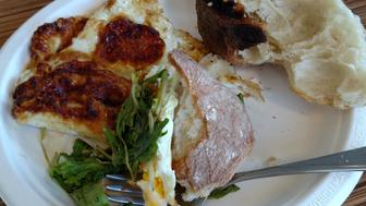 Stale ciabatta bread, old eggs, wilted arugula and a mealy peach.