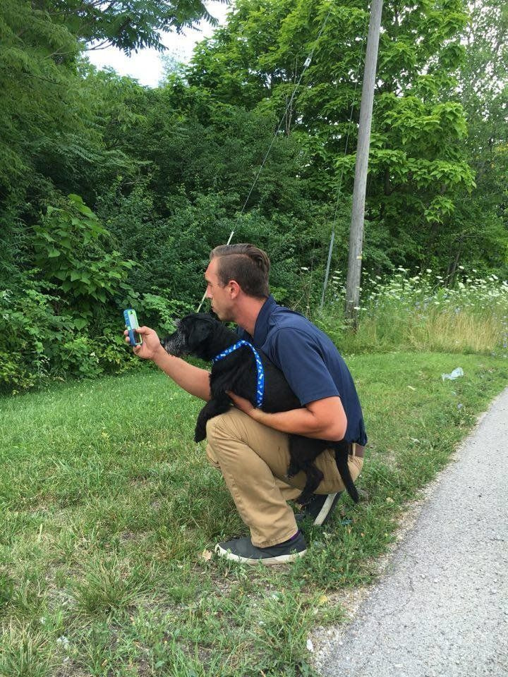 Phil Peckinpaugh and shelter dog Winston, catching a Squirtle.