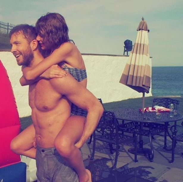 Calvin Harris and Taylor Swift during happier