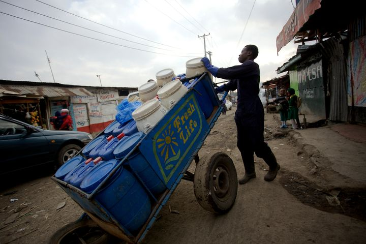 A Sanergy employee transportingthe collected waste to the facility for reuse.