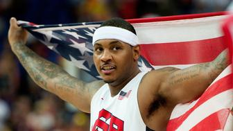 USA's Carmelo Anthony (15) celebrates following their victory over Spain in the Gold Medal game at the at the North Greenwich Arena during the 2012 Summer Olympic Games in London, England, Sunday, August 12, 2012. USA defeated Spain 107-100. (Harry E. Walker/MCT via Getty Images)