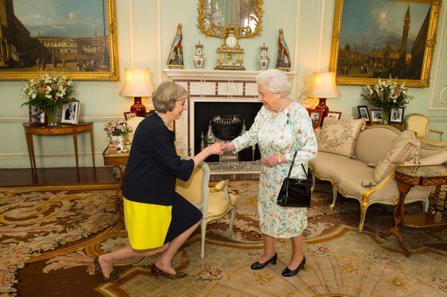 Queen Elizabeth II welcomes Theresa May at the start of an audience in Buckingham Palace, London, where...