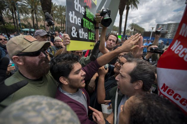 Anti-Trump protesters and Trump supporters clash outside a campaign rally by presumptive GOP presidential...