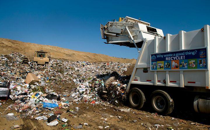 Crews unload trash at the Miramar Landfill in San Diego, California, U.S. Miramar Landfill, an environmentally secure and lin