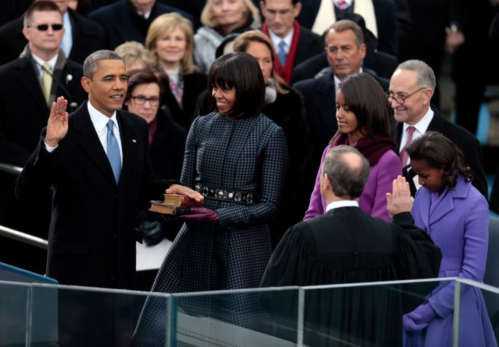 President Barack Obama takes the oath of office from Supreme Court Chief Justice John Roberts as first lady Michelle Obama ho