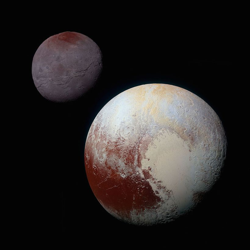 A composite of enhanced-color images of Pluto (lower right) and Charon (upper left), taken by NASA's New Horizons spacecraft