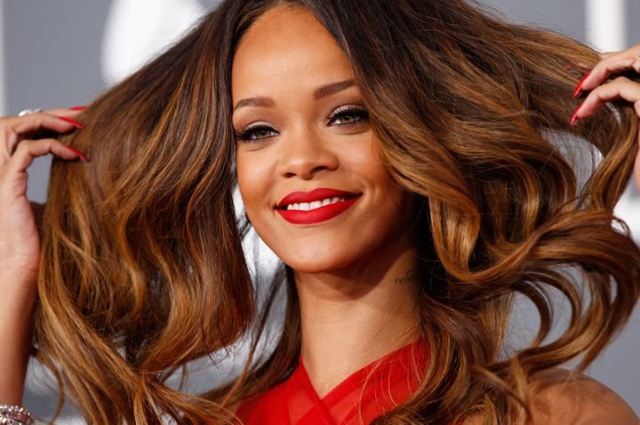 Rihanna has paid far more than Hollande to style her ever-changing 'do.