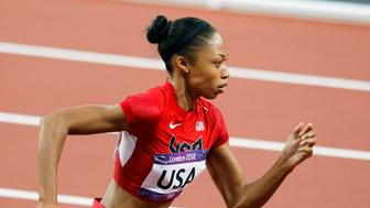 Allyson Felix of the U.S. runs to win gold in the women's 4x400m relay final at the London 2012 Olympic Games at the Olympic Stadium August 11, 2012. REUTERS/Gary Hershorn (BRITAIN  - Tags: SPORT ATHLETICS OLYMPICS)