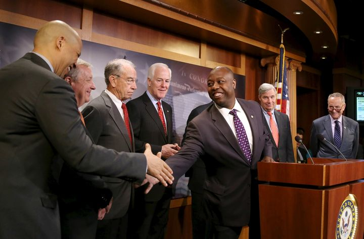 Sen. Tim Scott (R-S.C.) shakes hands with Sen. Cory Booker (D-N.J.) at a news conference on criminal justice reform, Oct. 1,
