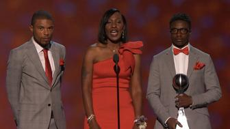 Zaevion Dobson's brothers and mother accept the Arthur Ashe Award on his behalf.