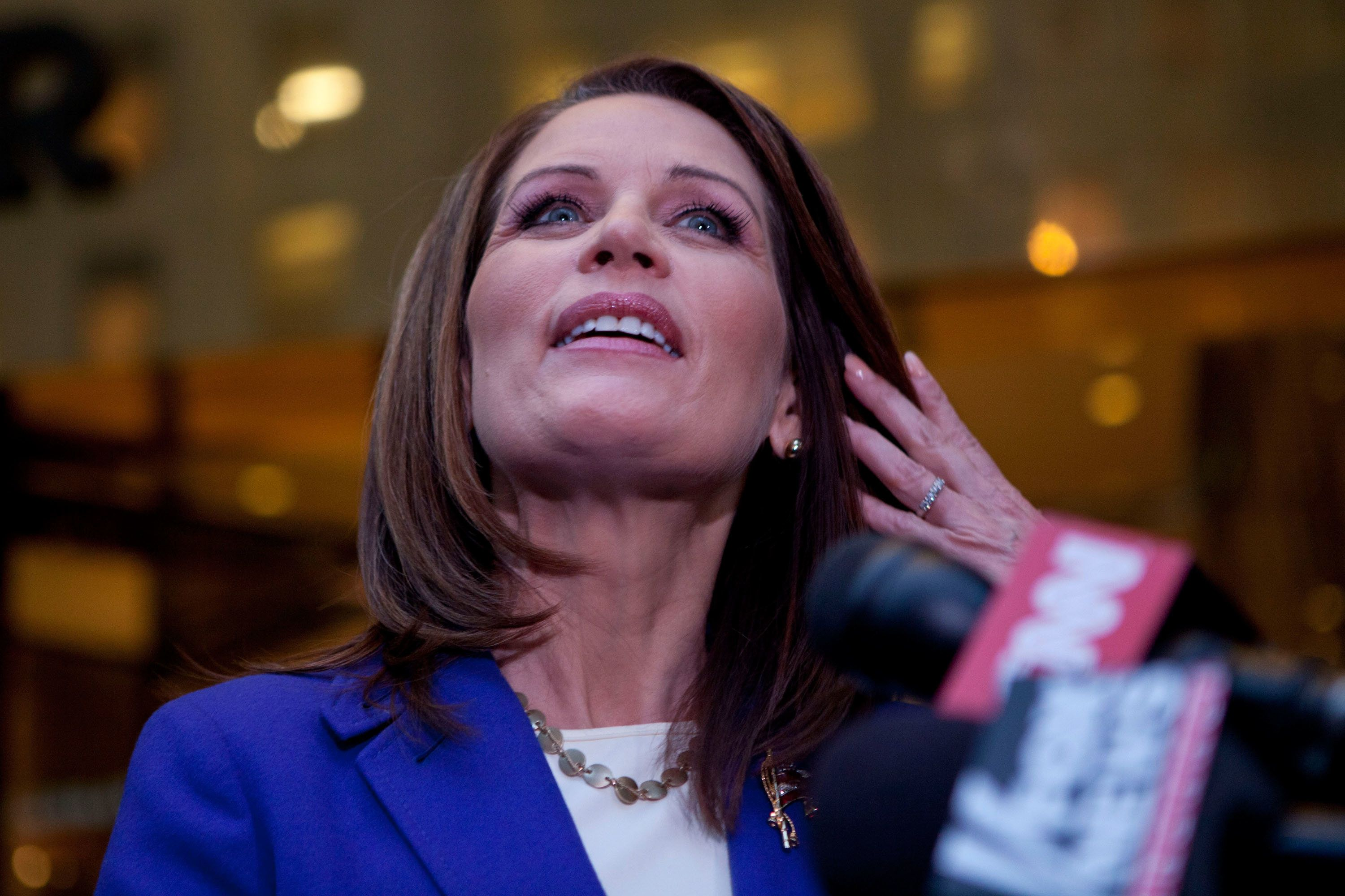 NEW YORK, NY - NOVEMBER 21:  Republican presidential candidate U.S. Rep Michele Bachmann (R-MN) wipes hair from her face while speaking to members of the media after meeting with Donald Trump at Trump Tower on 5th Avenue on November 21, 2011 in New York City. This is Bachman's fourth meeting with the developer and reality TV star since she started running for president.  (Photo by Andrew Burton/Getty Images)