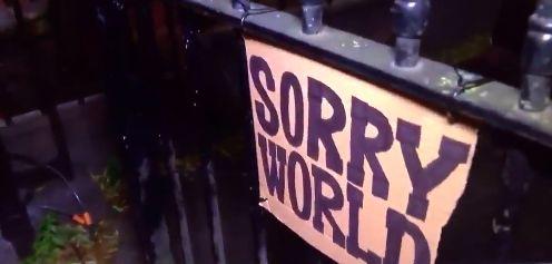'SORRY WORLD', the apology pinned to Boris Johnson's