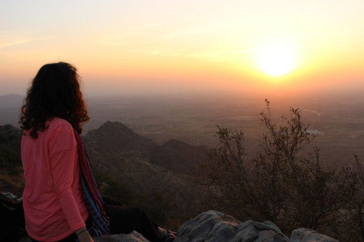 An impulsive hike up a mountain in India to catch a beautiful sunset.