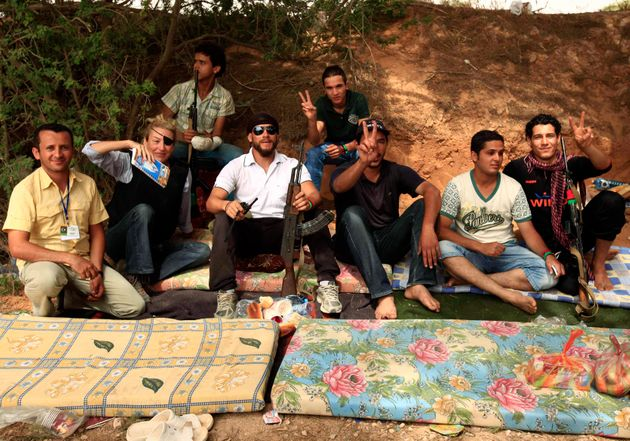 Colvin, second left, poses for a photograph with Libyan rebels in Misrata, northwestern Libya, on June...