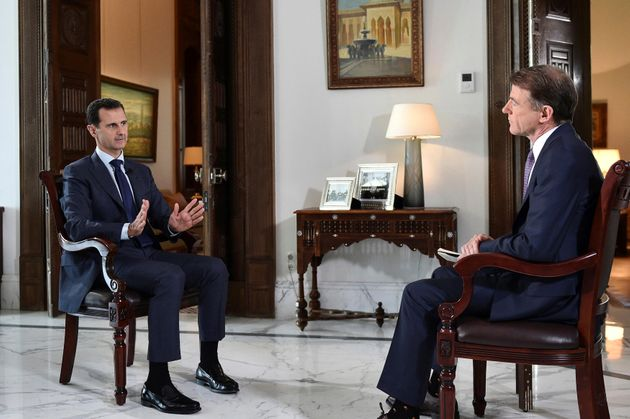Syria's Bashar Assad, left, denied any wrongdoing in the brutal civil war during a Damascus interview...