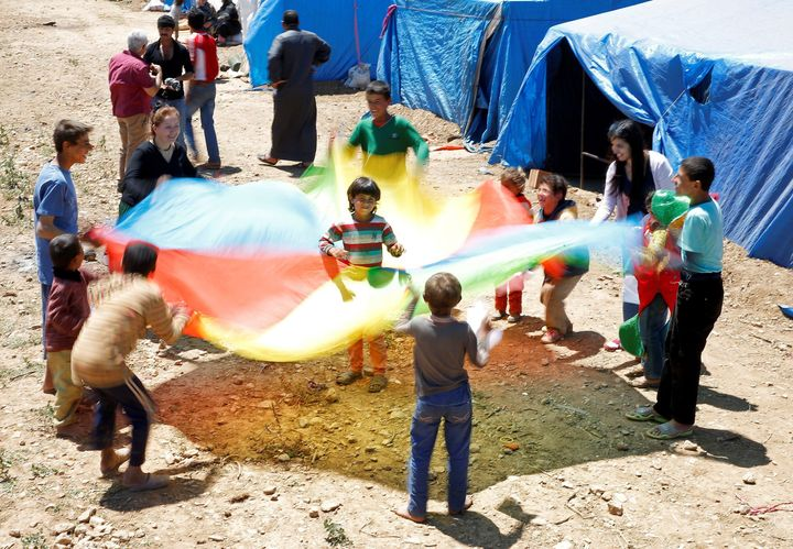 "Syrian refugee childrenare seen as they try to live with with help of non governmental organization called ""initiative to sup"