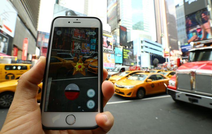 A Pokemon Go user plays Pokemon GO game in New York City in July 2016.