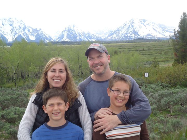 Amy and Brad Herzog with their two sons atGrand Teton National Park in 2011. The Herzogs were recently fired from their