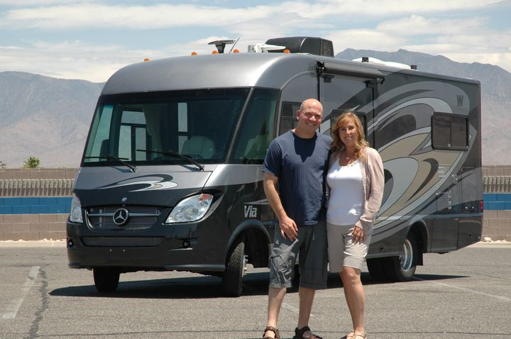 Brad and Amy Herzog in front of their RV for the summer in 2012. Brad Herzog described traveling across the country with his