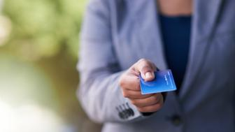 Shot of a businesswoman holding out a credit card