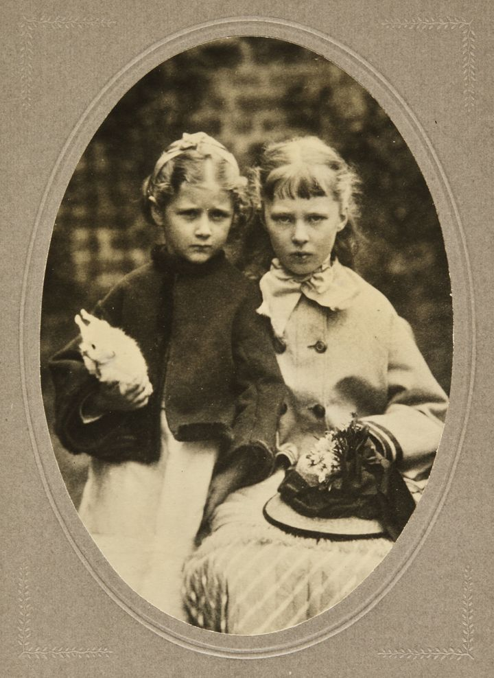 Beatrix Potter with a rabbit and her cousin Alice Crompton Potter.