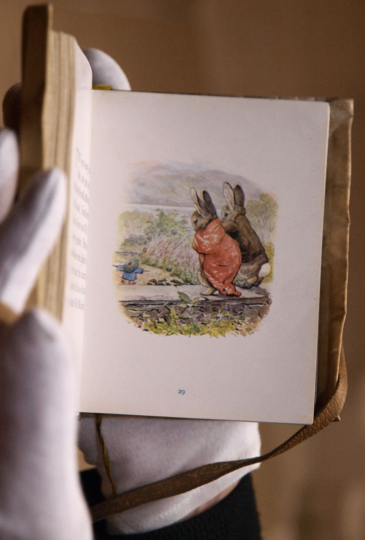"""The 1904 edition of """"The Tales of Beatrix Potter,"""" which Britain's Prince Charles had in his nursery, is pictured during a ph"""