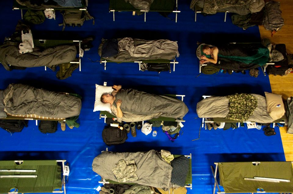 Service members sleep at the Osan Air Base, Republic of Korea, Fitness and Sports Complex during exercise Key Resolve, March