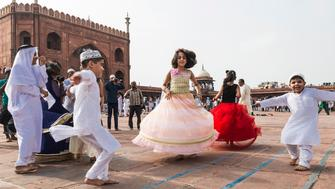 DELHI, INDIA - 2016/07/06: Children playing at the historic Jama Masjid lawn near Red Fort in New Delhi after the Eid-ul-Fitr morning prayer today. Eid-ul-Fitr, popularly known as Eid, is celebrated at the end of the holy month and on the first day of Shawwal, the month succeeding Ramadan. This is the most important festival for the Muslim Community across the world. (Photo by Sauvik Acharyya/Pacific Press/LightRocket via Getty Images)