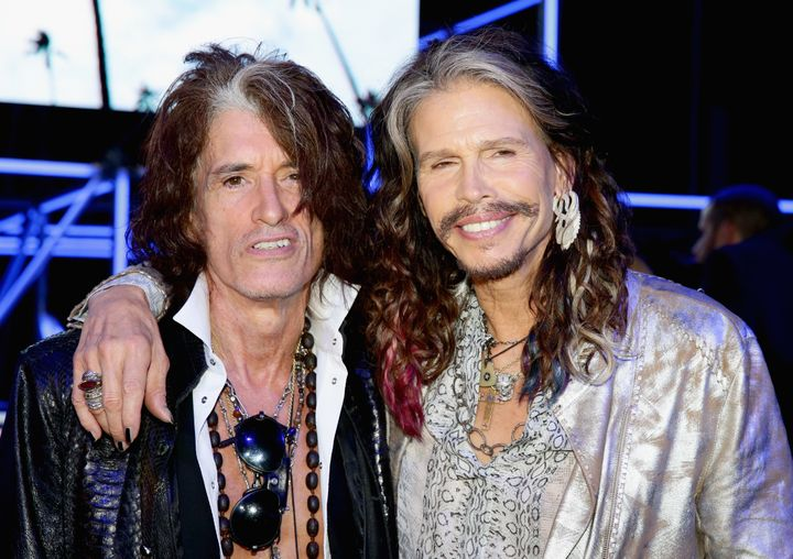 Joe Perry and Steven Tyler attend the Roberto Cavalli show during the Milan Menswear Fashion Week Spring Summer 2015 on June