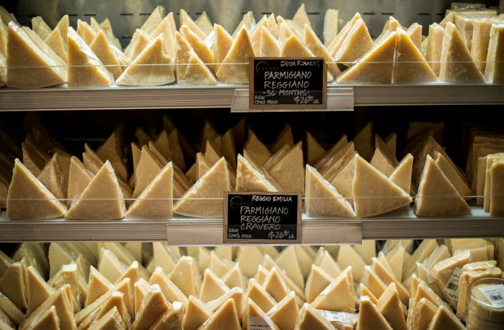 MANHATTAN, NEW YORK - SEPTEMBER 16: Different types of Parmigiano Reggiano on sale at Eataly in New York City, New York, Wedn