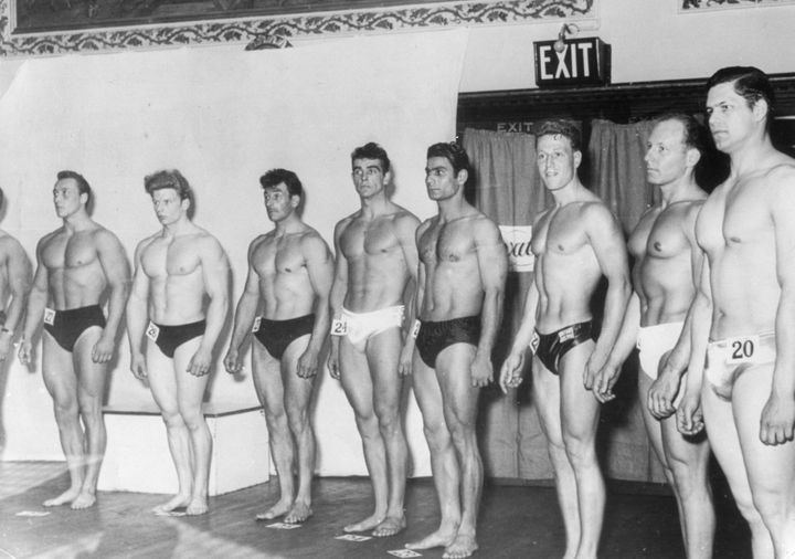 Sean Connery, at center, poses during a bodybuilding competition.