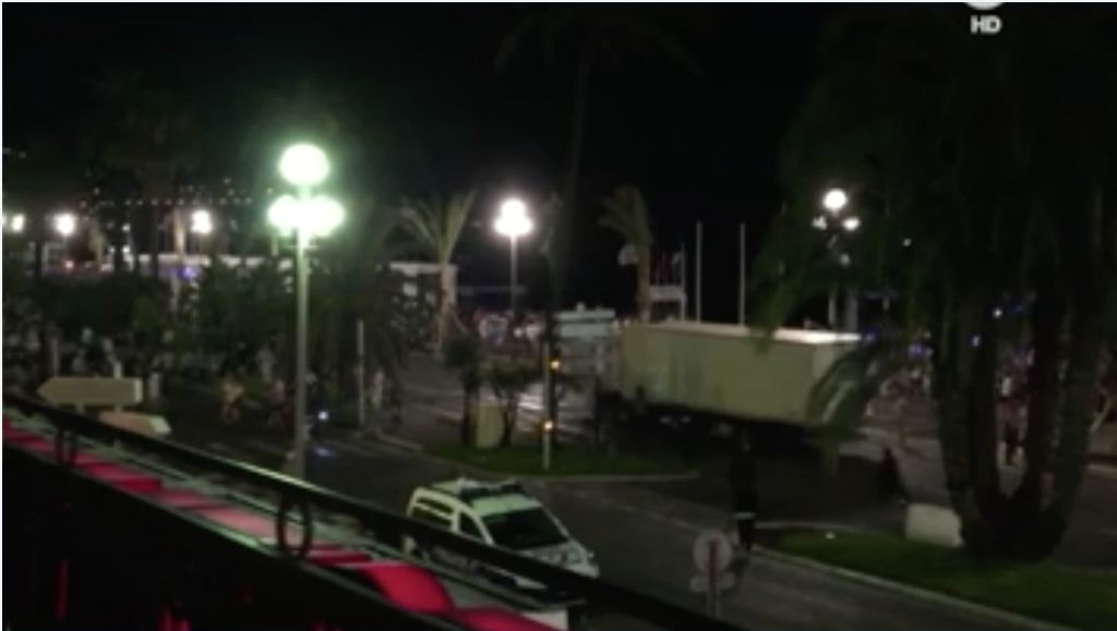 An image from a video shows the large truck as it plows through a crowd a people in Nice,