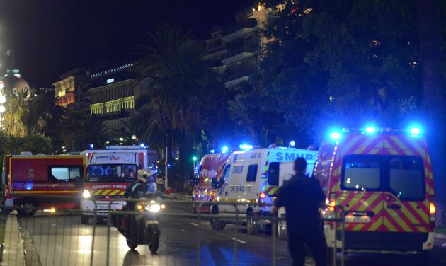French police and rescue forces vehicles are seen on the Promenade des