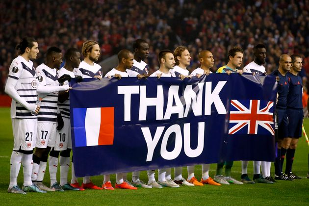 The Bordeaux team hold a banner thanking the British people for their recent support in the wake of the...