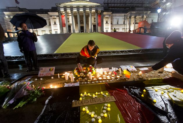 People leaving leave flowers and candles during a vigil in Trafalgar Square in London, to pay tribute...