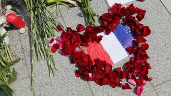 MOSCOW, RUSSIA - JULY 15, 2016: Flowers outside the French Embassy in Moscow commemorating victims of the 2016 terror attack in the French resort city of Nice. On 14 July 2016, a truck ploughed into a crowd of people celebrating Bastille Day on the Promenade des Anglais. 84 people were killed in the attack. Sergei Savostyanov/TASS (Photo by Sergei Savostyanov\TASS via Getty Images)