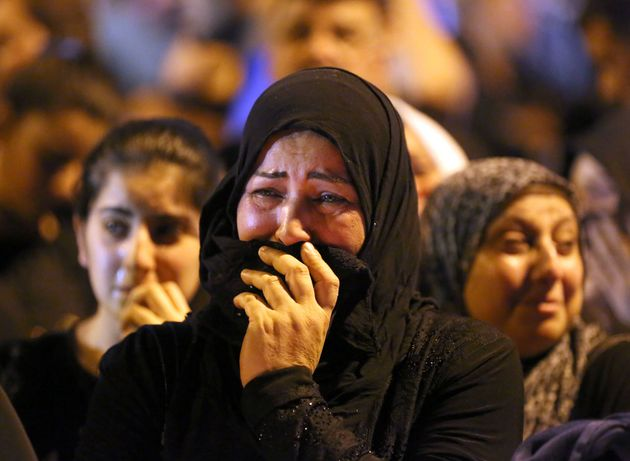 A woman grieves at the scene of the deadly truck