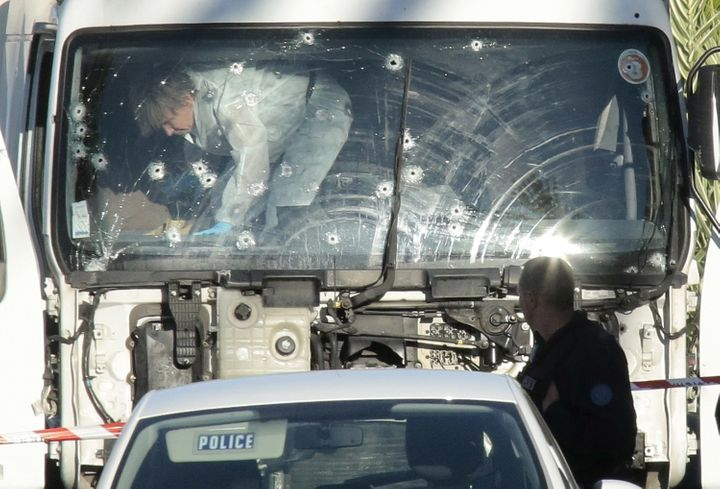 Police investigate a truck riddled with bullets at the scene of a terror attack in Nice, France.