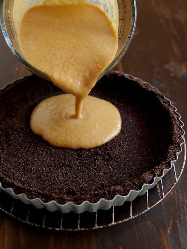 """Get the recipe for this <a href=""""http://www.completelydelicious.com/2014/11/chocolate-swirl-pumpkin-tart-with-chocolate-cookie-crust.html"""" target=""""_blank"""">Chocolate Swirl Pumpkin Tart with Chocolate Cookie Crust</a>from Completely Delicious"""