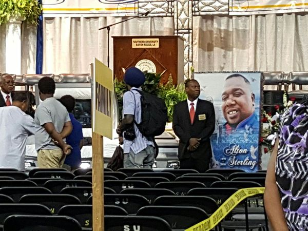 People arrive to the funeral for Alton Sterling.