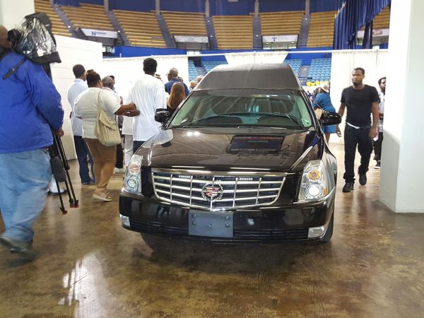 The hearse carrying the body of Alton Sterling arrives at his funeral in Baton Rouge.