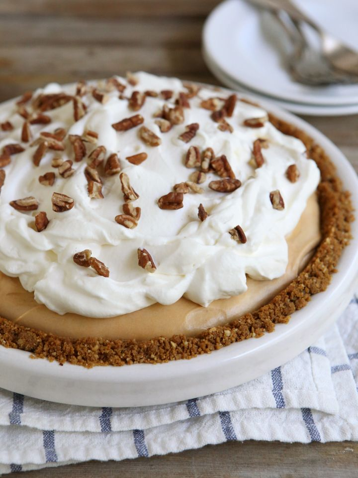 """Get the <a href=""""http://www.completelydelicious.com/2014/10/caramel-cream-pie-with-gingersnap-pecan-crust.html"""" target=""""_blank"""">Caramel Cream Pie with Gingersnap Pecan Crust recipe</a>from Completely Delicious"""