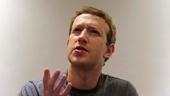 President, founder and CEO of Facebook Mark Zuckerberg speaks during a Reuters interview at the University of Bogota January 14, 2015. Facebook Inc on Wednesday launched a mobile phone application that gives Colombian users free access to a handful of online services, broadening Zuckerberg's effort to boost Internet usage in developing markets.  REUTERS/Jose Miguel Gomez (COLOMBIA - Tags: BUSINESS POLITICS SCIENCE TECHNOLOGY HEADSHOT TPX IMAGES OF THE DAY)