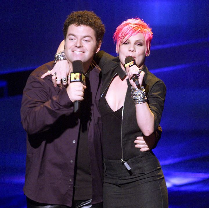 In 2000, Holmes and P!nk emceed the Music With A Message: World AIDS Day concert in New York.