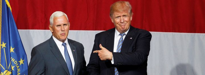 Presumptive GOP presidential candidate Donald Trump points to Indiana Gov. Mike Pence before addressing the crowd during a campaign stop at the Grand Park Events Center in Westfield, Indiana, July 12, 2016.