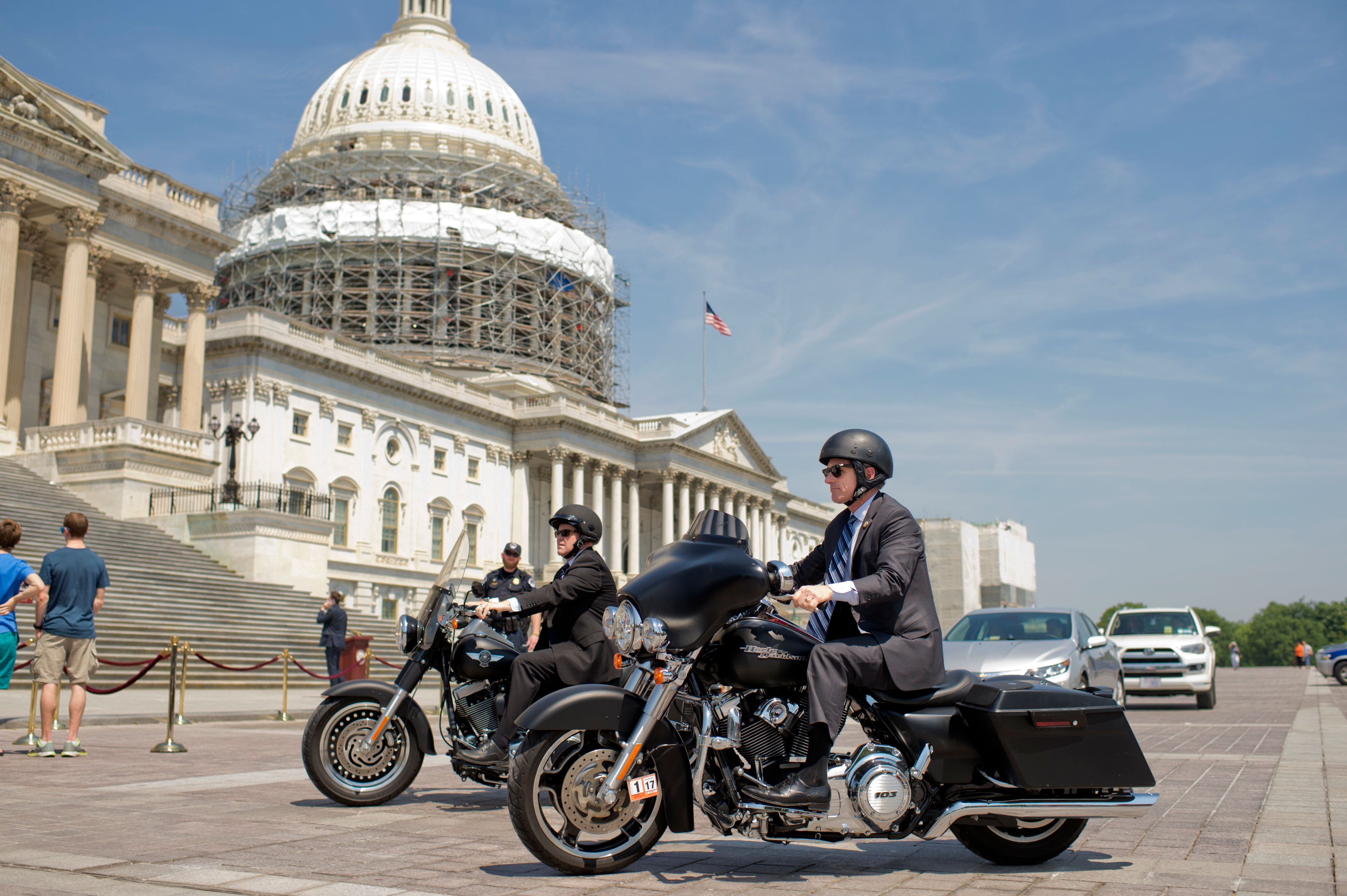 UNITED STATES - MAY 26: Reps. Scott Rigell, R-Va., right, and Reid Ribble, R-Wis., ride their Harley-Davidson motorcycles on the East Front of the Capitol after the last votes in the House which begins the Memorial Day recess, May 26, 2016. (Photo By Tom Williams/CQ Roll Call)