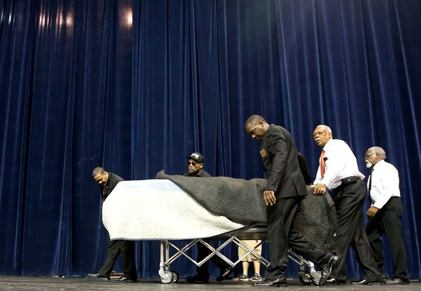 The body of Alton Sterling,lies in a casket as he is brought into his funeral at Southern University on July 15, 2016 in Bato