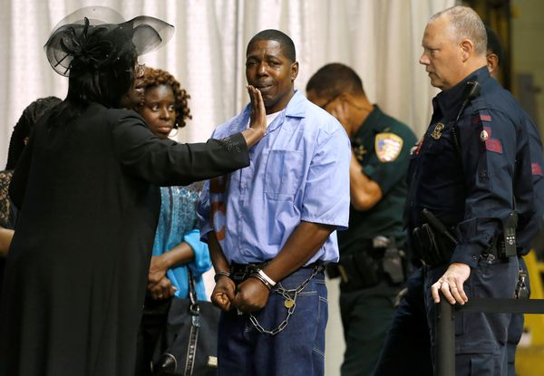 An inmate with the Louisiana Department of Corrections is consoled by friends and family.