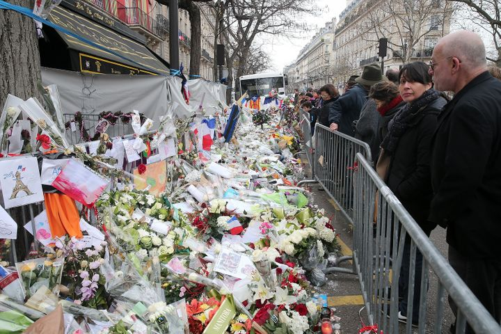 People gather atthe Bataclan concert hall on Dec. 13, 2015, to mourn the victims of the attacka month earlier.